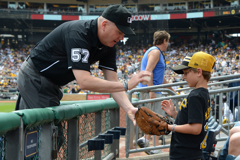 First dad gives a foul ball to his 4-year-old daughter.  She throws it on the field. When the umpire came to return it, she really didn't want it so the umpire gave it to her brother.