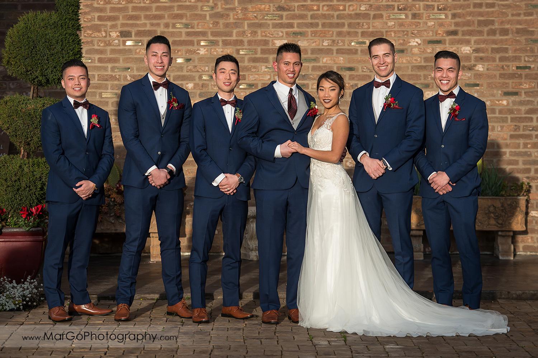 bride, groom and groomsmen under LOVE sign at Sunol's Casa Bella