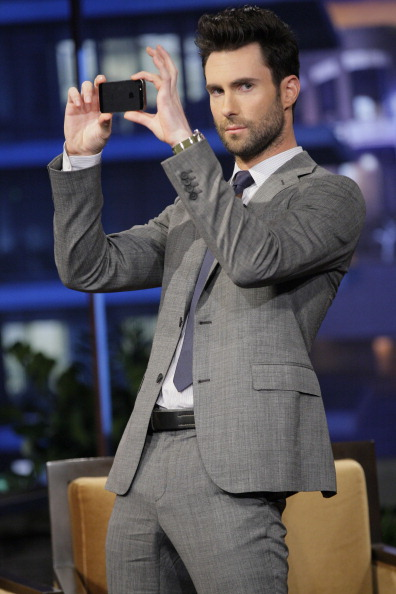 . THE TONIGHT SHOW WITH JAY LENO -- (EXCLUSIVE COVERAGE) -- Episode 4444 -- Pictured: Adam Levine takes a picture of the audience during a commercial break on April 12, 2013 -- (Photo by: Chris Haston/NBC/NBCU Photo Bank via Getty Images)