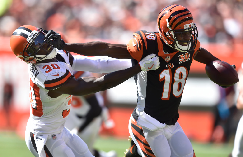 . Cincinnati Bengals wide receiver A.J. Green (18) blocks Cleveland Browns defensive back Jason McCourty (30) in the first half of an NFL football game, Sunday, Oct. 1, 2017, in Cleveland. (AP Photo/David Richard)