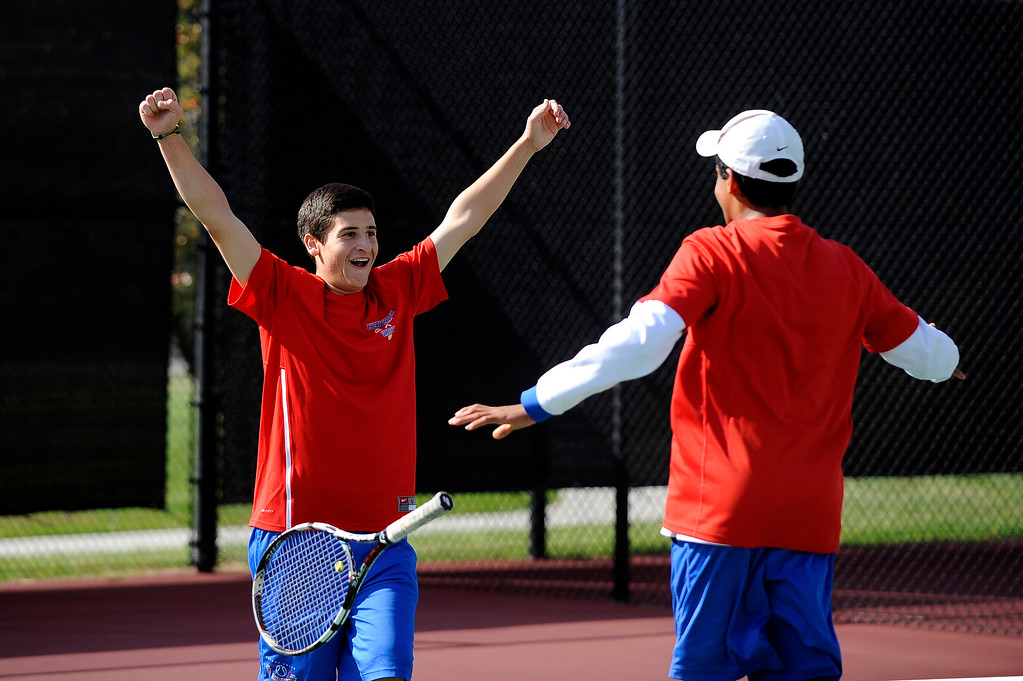 . DENVER, CO. - OCT 12:   Jake Miller of Cherry Creek raises his hands in celebration as he is joined by his doubles partner Harshil Dwivedi. The pair won the #1 doubles match against Fairview during the final day of the 5A Boys\' Tennis Championships at Gates Tennis Center on Oct. 12, 2013.  (Photo By Erin Hull/The Denver Post)