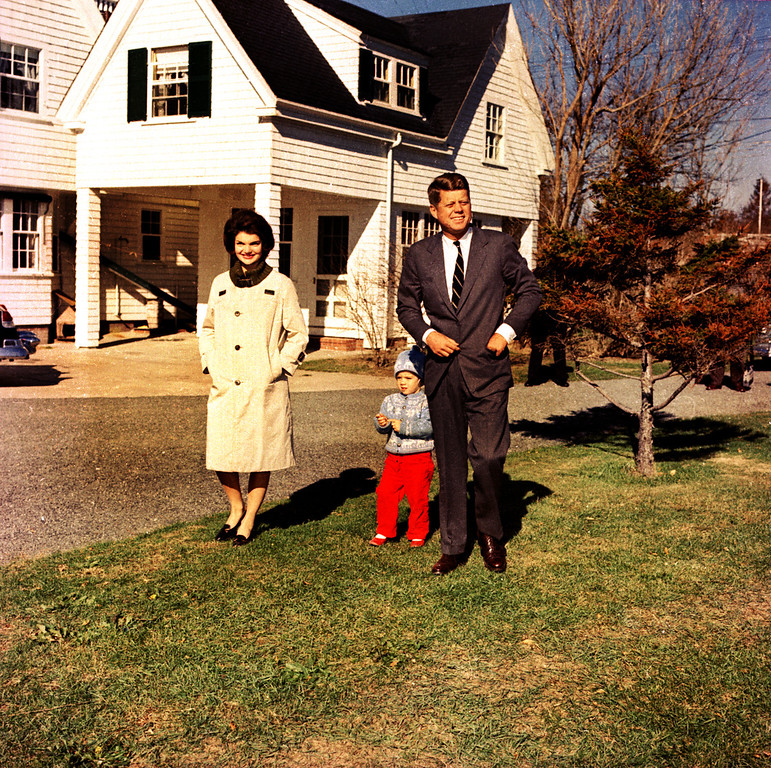 """. FILE - In this Nov. 8, 1960 file photo, John F. Kennedy takes a stroll with his wife, Jacqueline Kennedy, and their daughter, Caroline, at Hyannis Port, Mass. The Kennedy image, the \""""mystique\"""" that attracts tourists and historians alike, did not begin with his presidency and is in no danger of ending 50 years after his death. Its journey has been uneven, but resilient _ a young and still-evolving politician whose name was sanctified by his assassination, upended by discoveries of womanizing, hidden health problems and political intrigue, and forgiven in numerous polls that place JFK among the most beloved of former presidents. (AP Photo)"""