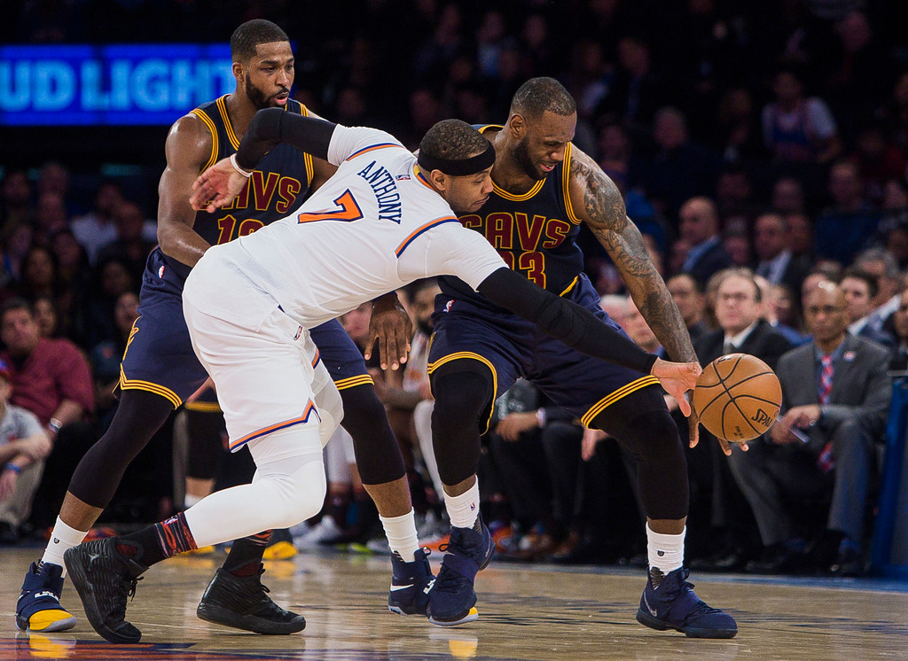 . Cleveland Cavaliers\' LeBron James, right, has the ball knocked away by New York Knicks\' Carmelo Anthony (7) during the second half of an NBA basketball game, Saturday, Feb. 4, 2017, in New York. (AP Photo/Andres Kudacki)