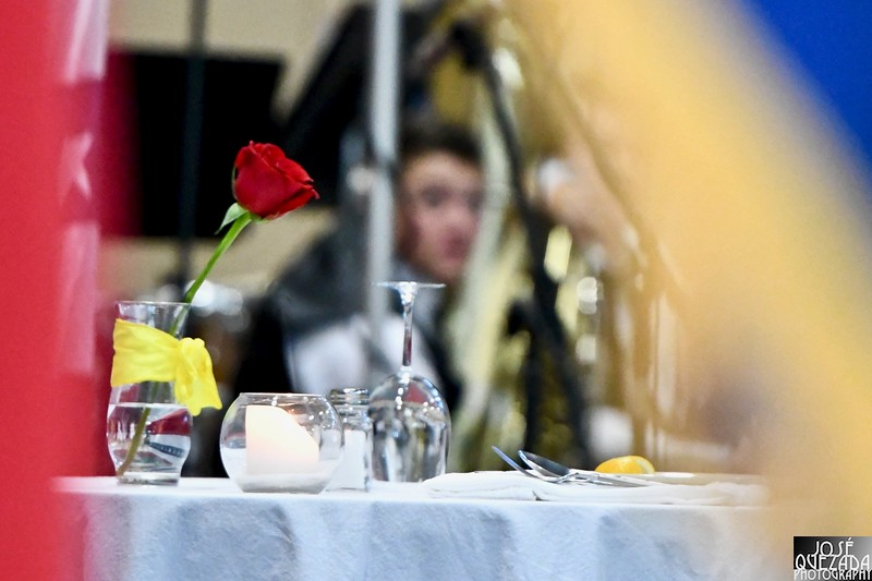 A close-up through military flags of the Missing Man Table.