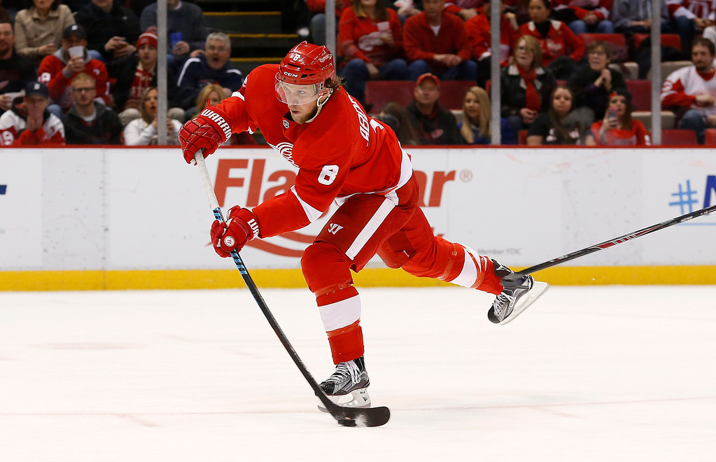 . Detroit Red Wings left wing Justin Abdelkader shoots against the Tampa Bay Lightning in the second period of an NHL hockey game in Detroit Saturday, March 28, 2015. Abdelkader scored on the shot. (AP Photo/Paul Sancya)
