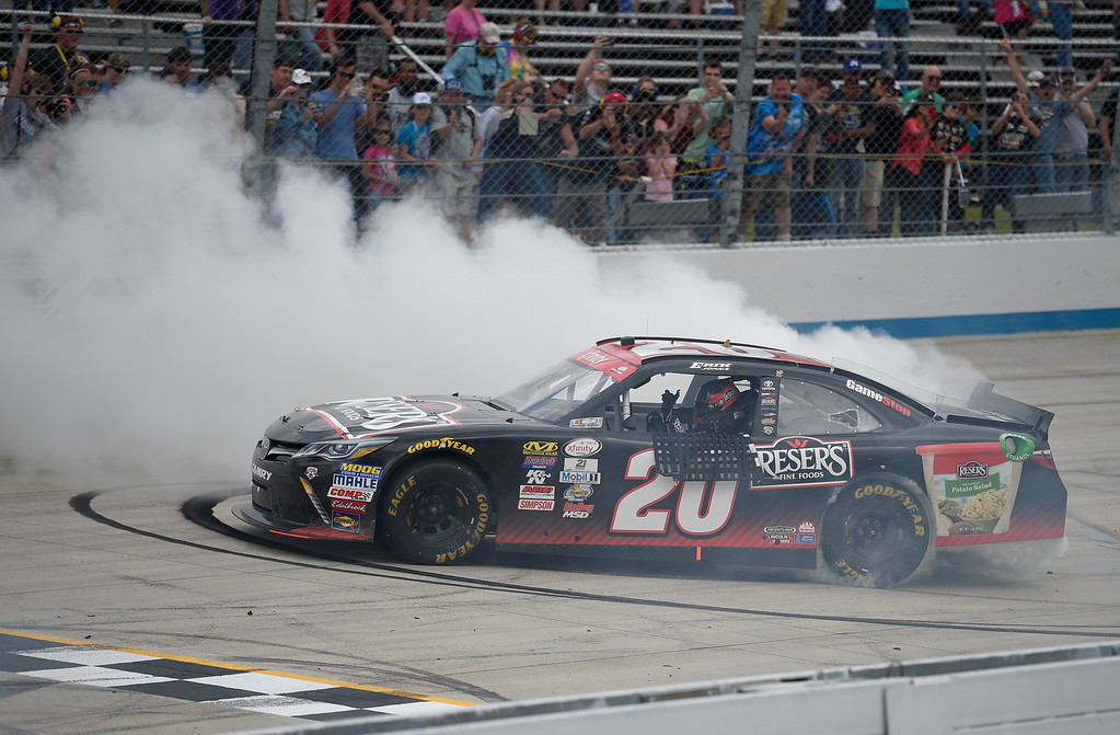 . Erik Jones performs a burnout after winning the NASCAR Xfinity series auto race, Saturday, May 14, 2016, at Dover International Speedway in Dover, Del. (AP Photo/Nick Wass)