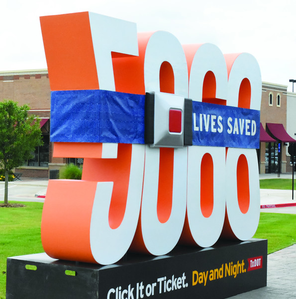 A sculpture of the number 5068 with a seat belt around it sits at The Village of Cumberland Park on Tuesday signifying the number of people saved by wearing seatbelts since the inception of the Click it or Ticket campaign in 2002. (LouAnna Campbell/Tyler Morning Telegraph)