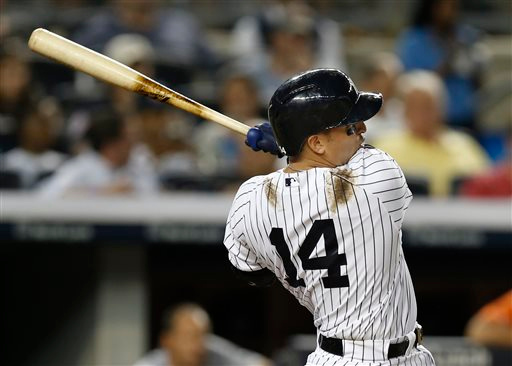 . New York Yankees Martin Prado hits a fifth-inning solo home run off Detroit Tigers starting pitcher David Price in a baseball game at Yankee Stadium in New York, Tuesday, Aug. 5, 2014.  (AP Photo/Kathy Willens)