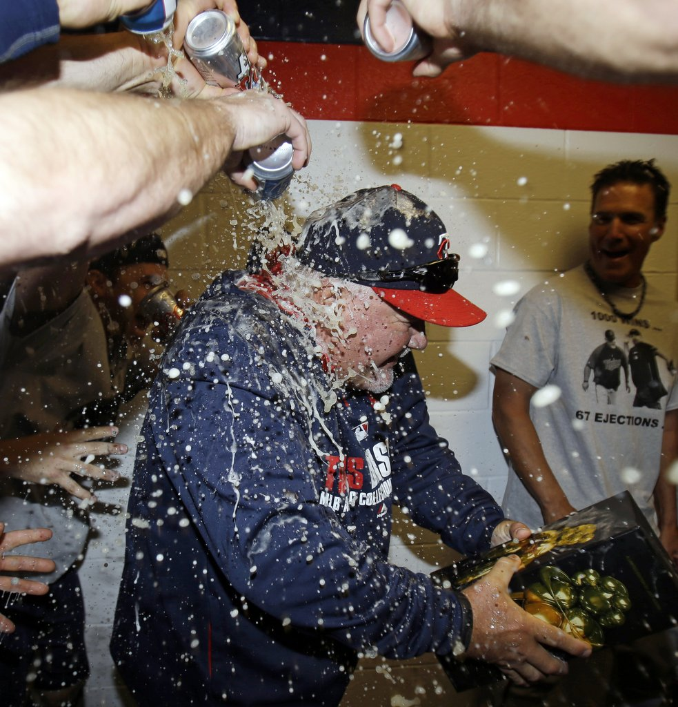 """. <p><b> The Twins gave manager Ron Gardenhire a beer shower Saturday after he did this for the 1,000th time � </b> <p> A. Won a major league game <p> B. Managed a major league game <p> C. Pulled his starting pitcher before the third inning <p><b><a href=\' http://photos.twincities.com/2014/04/05/gardy-notches-1000th-win-as-the-minnesota-twins-beat-cleveland-7-3/\' target=\""""_blank\"""">HUH?</a></b> <p>   (AP Photo/Tony Dejak)"""
