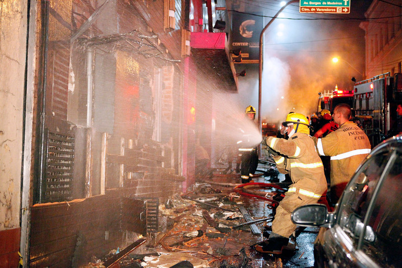 . Firefighters try to put out a fire at a nightclub in Santa Maria, 550 Km from Porto Alegre, southern Brazil on January 27, 2012. The death toll climbed to 150 early Sunday as firefighters searched the charred remains of the establishment, television Globo reported. AGENCIA RBS/AFP/Getty Images