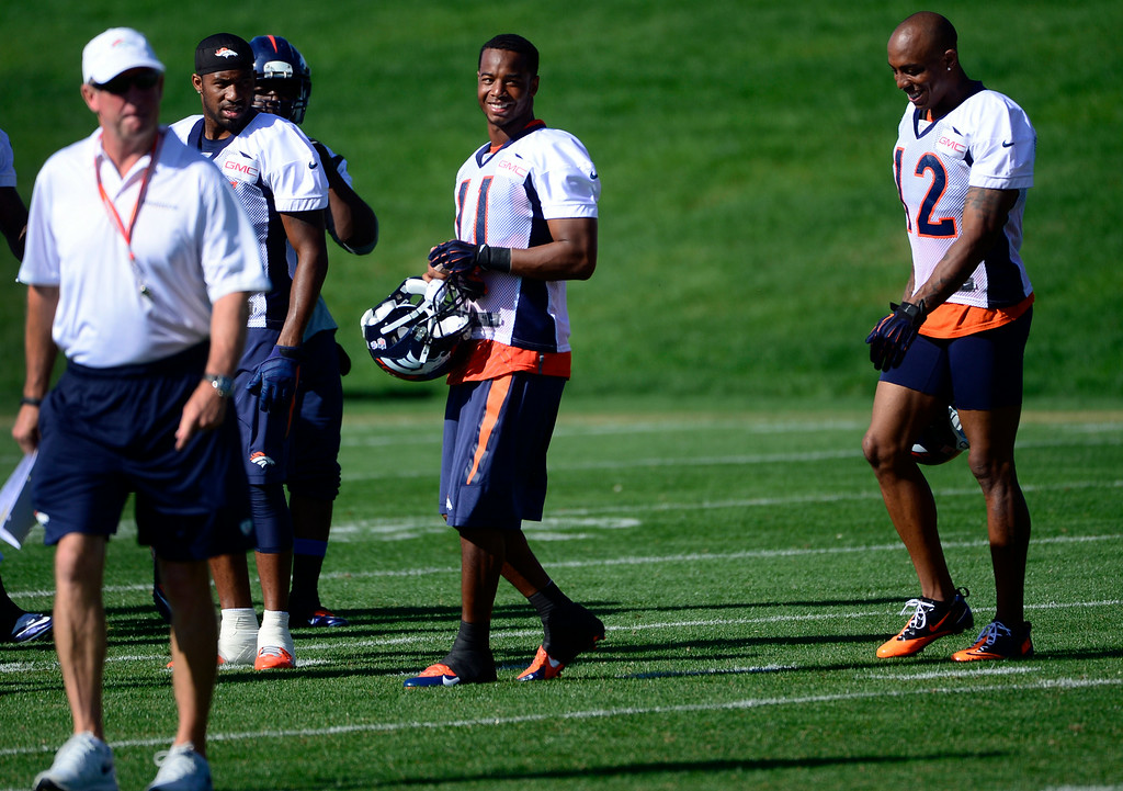 . After warm-ups, Jordan Norwood (11) heads to the practice field with fellow wide receivers and head coach John Fox. The Denver Broncos football team gets in their final day of practice during training camp at Dove Valley  on Friday, Aug. 15, 2014. (Photo by Kathryn Scott Osler/The Denver Post)