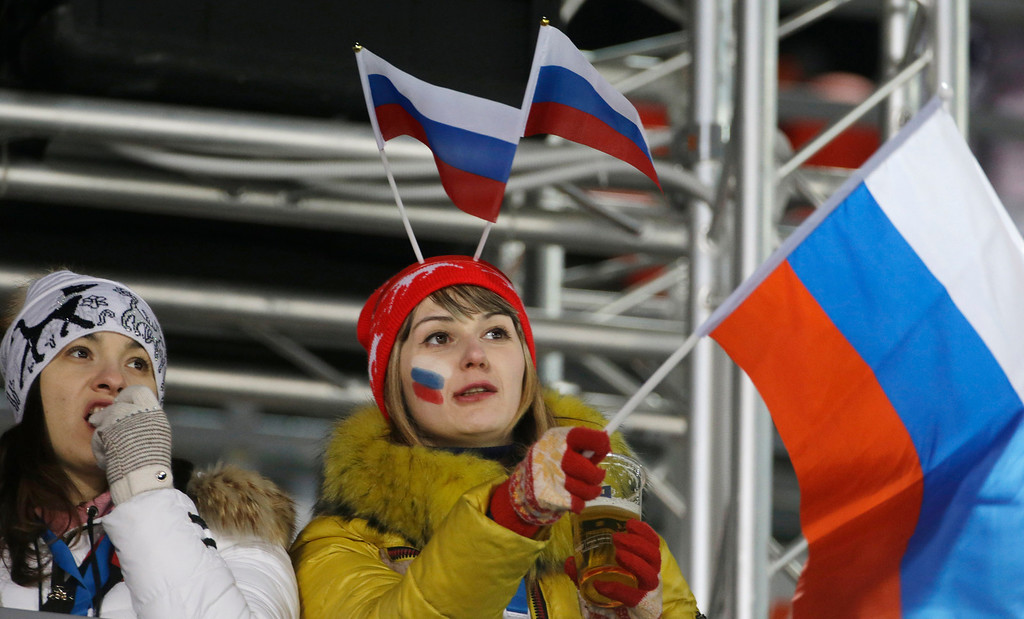 . Russian fans watch the men\'s normal hill ski jumping qualification at the 2014 Winter Olympics, Saturday, Feb. 8, 2014, in Krasnaya Polyana, Russia. (AP Photo/Gregorio Borgia)