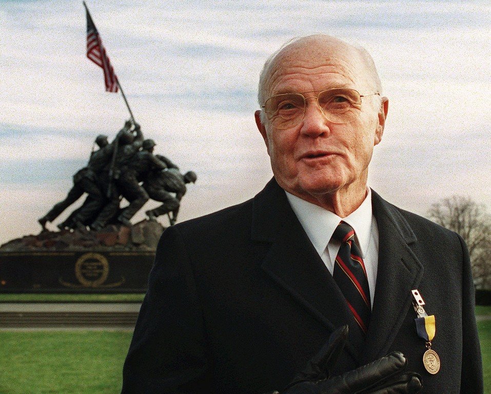 . Senator John Glenn wears the Distinguished Public Services Award medal received from the United States Marine Corps during a ceremony at the U.S. Marine Corps War Memorial in Arlington, Va. Thursday, Dec. 10, 1998, commemorating  the Senator\'s more than 50 years of service to the country.  More than a month after his 3.7 million-mile space shuttle trip, John Glenn is logging a lot of miles on Earth, still getting various honors.(AP Photo/Linda Spillers)