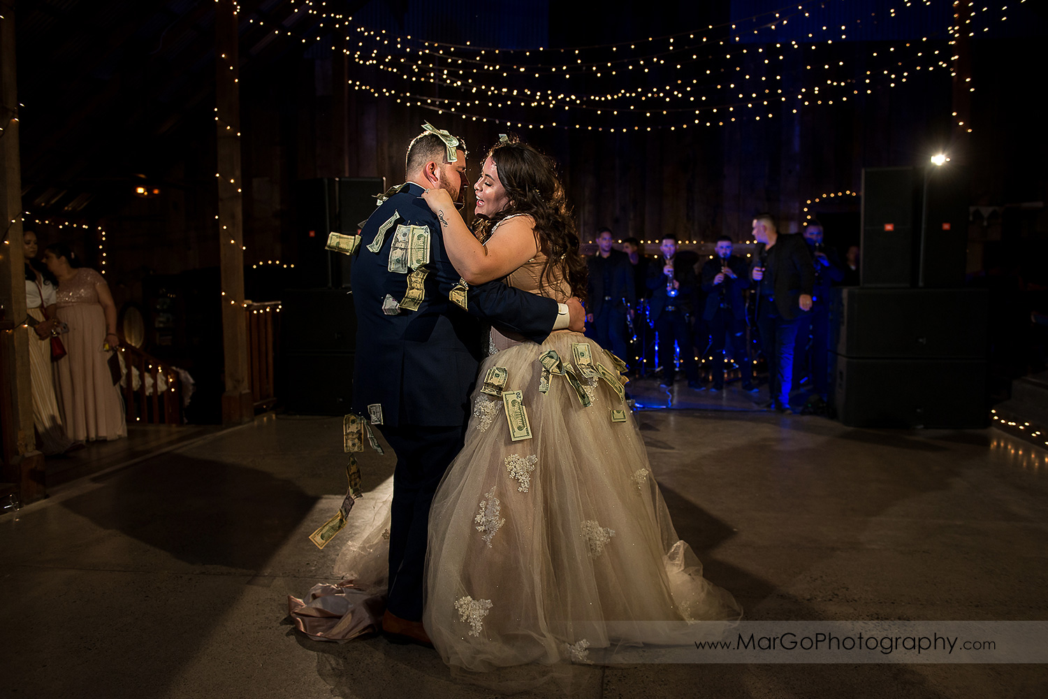money dance of bride and groom during wedding reception at Taber Ranch Vineyards