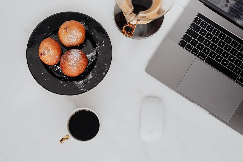kaboompics_Marble desk with laptop, homemade Polish doughnuts and coffee.jpg