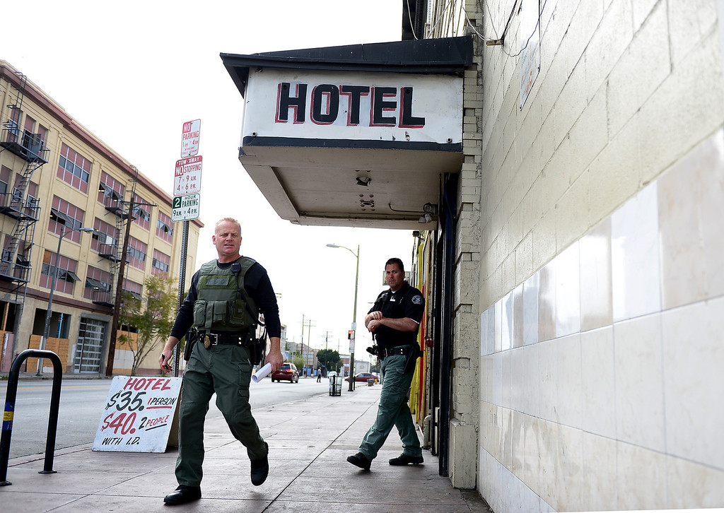 . Los Angeles County Special Enforcement Probation officers Aldin Tatley and Jon Reinke leave a Los Angeles hotel where they conducted a sex offender compliance check Thursday, April 25, 2013. The county has 30 armed probation officers and is seeking more armed officers to deal with realignment, the release of low-level inmates from state to county supervision. (SGVN/Staff Photo by Sarah Reingewirtz)