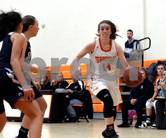 12/12/2017 Mike Orazzi | Staff Terryville's Mackenzie Huria (14) during Tuesday night's girl's basketball game with Shepaug.