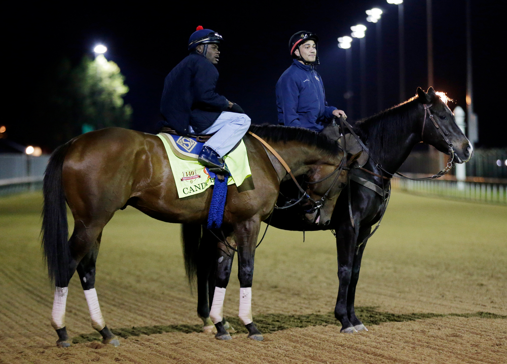 . Exercise rider Jelani Grant takes Kentucky Derby entrant Candy Boy for a morning workout at Churchill Downs Thursday, May 1, 2014, in Louisville, Ky. (AP Photo/Charlie Riedel)