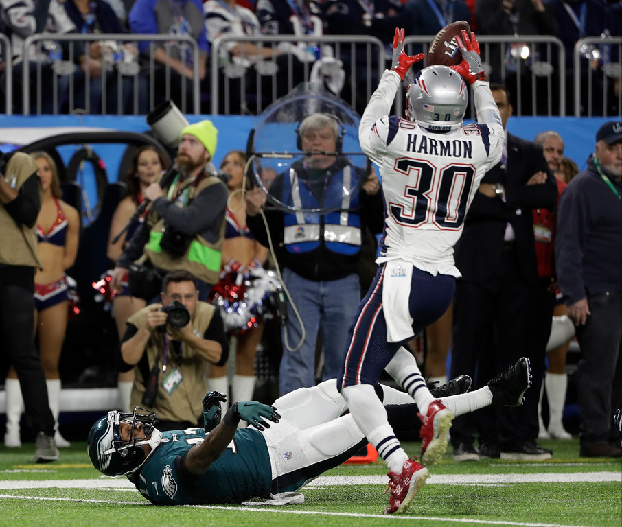 . New England Patriots strong safety Duron Harmon (30) grabs a ball for an interception after Philadelphia Eagles wide receiver Alshon Jeffery (17) misses a catch, during the first half of the NFL Super Bowl 52 football game, Sunday, Feb. 4, 2018, in Minneapolis. (AP Photo/Chris O\'Meara)