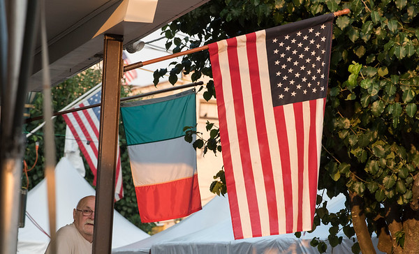 07/26/19 Wesley Bunnell | Staff The American and Italian flags fly during the first night of the Italian Festival in Southington on Friday night.
