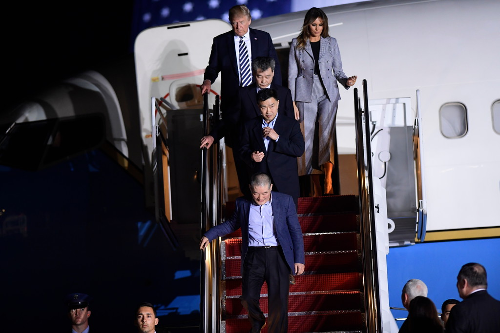 . Three Korean-Americans who were detained in North Korea for more than a year, Kim Dong Chul, bottom, Tony Kim, middle, followed by Kim Hak Song, get off a military air plane after they were greeted by President Donald Trump and first lady Melania Trump upon their arrival at Andrews Air Force Base in Md., Thursday, May 10, 2018. The three Korean-Americans were greeted by Trump beneath a giant American flag after they returned to the mainland U.S. early Thursday. (AP Photo/Susan Walsh)