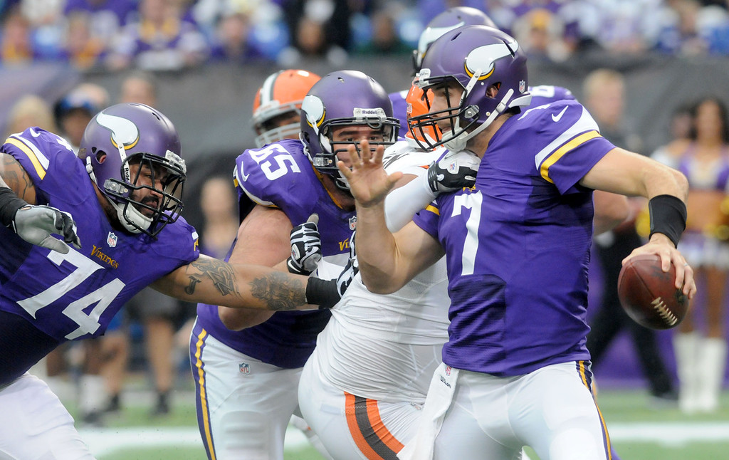 . Vikings quarterback Christian Ponder is grabbed and eventually sacked for a six-yard loss by Browns defensive end Billy Winn during the first quarter. (Pioneer Press: Sherri LaRose-Chiglo)