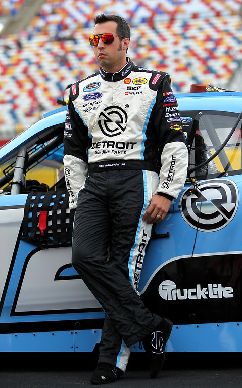. CONCORD, NC - OCTOBER 11:  Sam Hornish Jr., driver of the #12 Detroit Genuine Parts Ford, stands on the grid during qualifying for the NASCAR Nationwide Series Dollar General 300 at Charlotte Motor Speedway on October 11, 2013 in Concord, North Carolina.  (Photo by Jonathan Ferrey/Getty Images)