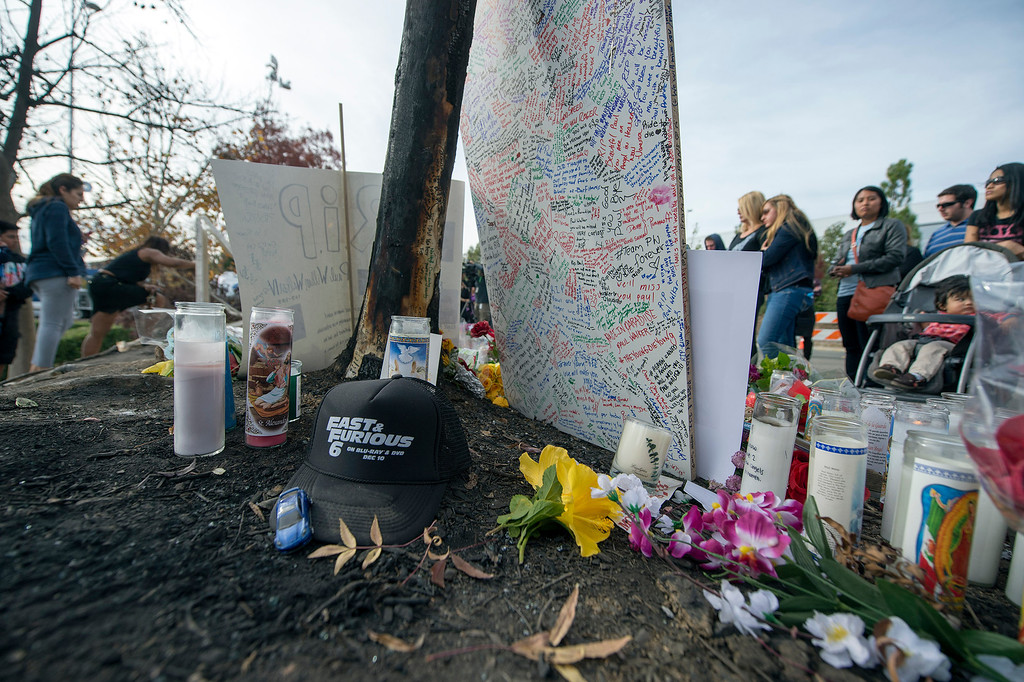 . Objects left by grieving fans at a memorial for actor Paul Walker who was killed on Saturday, November 30, 2013 in Valencia, Ca. Walker was in a 2005 Porsche Carrera GT, believed to be driven by his friend Roger Rodas, that crashed and burst in to flames killing both occupants. (Photo by Hans Gutknecht/Los Angeles Daily News)