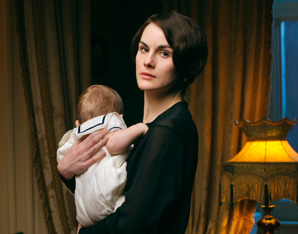 """. This photo released by PBS and Carnival Film and Television Limited shows Michelle Dockery as Lady Mary in a scene from the  fourth season of the Masterpiece TV series, \""""Downton Abbey.\"""" The show was nominated for a Golden Globe for best drama series on Thursday, Dec. 11, 2014. The 72nd annual Golden Globe awards will air on NBC on Sunday, Jan. 11. (AP Photo/PBS/Masterpiece, Nick Briggs)"""