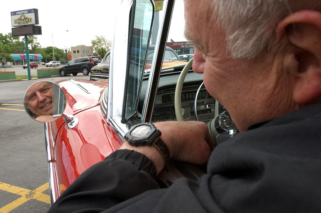 . Paul Scharfenberg, of Detroit, is all ready to cruise in his 1958 Cadillac Coupe, while at the 2005 Woodward Dream Cruise kick off party at Duggan\'s Irish Pub in Royal Oak, Wednesday May 25, 2005.