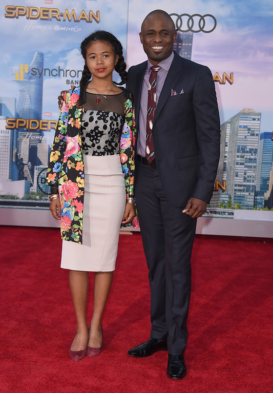 """. Wayne Brady, right, and his daughter Maile Masako Brady arrive at the Los Angeles premiere of \""""Spider-Man: Homecoming\"""" at the TCL Chinese Theatre on Wednesday, June 28, 2017. (Photo by Jordan Strauss/Invision/AP)"""