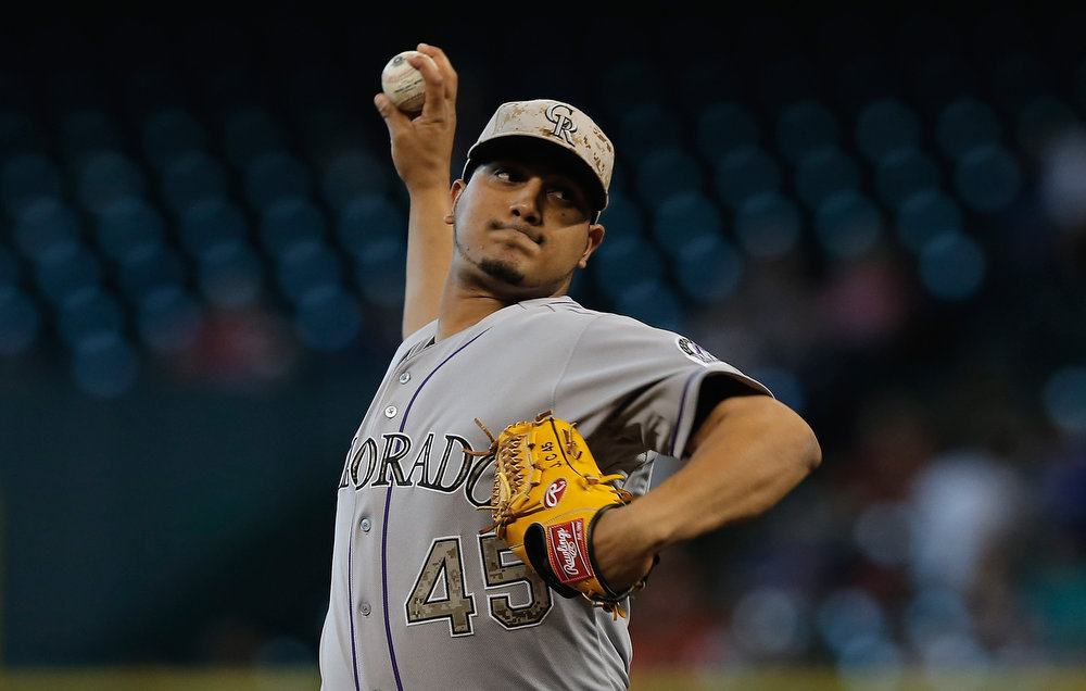 . Jhoulys Chacin #45  of the Colorado Rockies throws a pitch during the first inning against the Houston Astros at Minute Maid Park on May 27, 2013 in Houston, Texas.  (Photo by Scott Halleran/Getty Images)