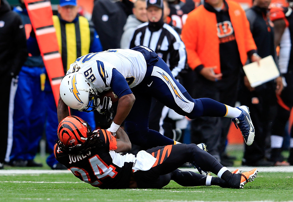 . Tight end Ladarius Green #89 of the San Diego Chargers is tackled by cornerback Adam Jones #24 of the Cincinnati Bengals during a Wild Card Playoff game at Paul Brown Stadium on January 5, 2014 in Cincinnati, Ohio.  (Photo by Rob Carr/Getty Images)