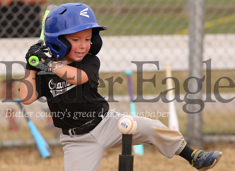 Joseph Ulintz, 4, takes a big swing for a hit during a Shetland 4 Cranberry youth game at Graham Park in Cranberry Thursday. Seb Foltz/Butler Eagle 07/23/20