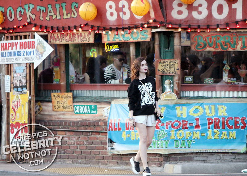 """EXCLUSIVE: Lily Collins Fashions A """"In the Dust Of This Planet"""" Sweater On Sunset Boulevard, LA"""