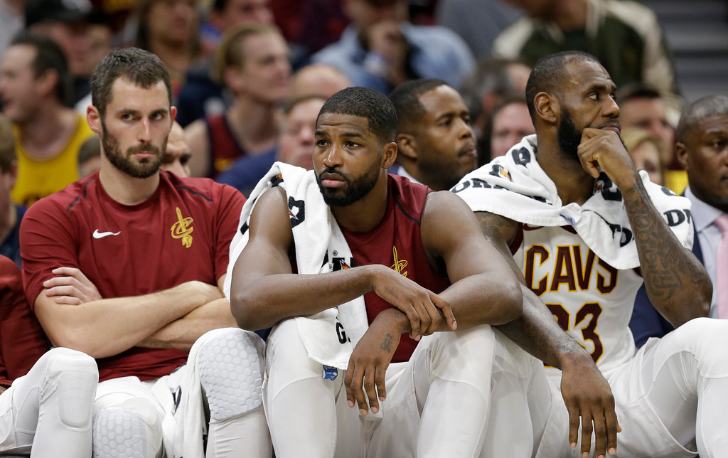 . Cleveland Cavaliers\' Kevin Love, left to right, Tristan Thompson and LeBron James sit on the bench in the second half of an NBA basketball game against the Orlando Magic, Saturday, Oct. 21, 2017, in Cleveland. (AP Photo/Tony Dejak)