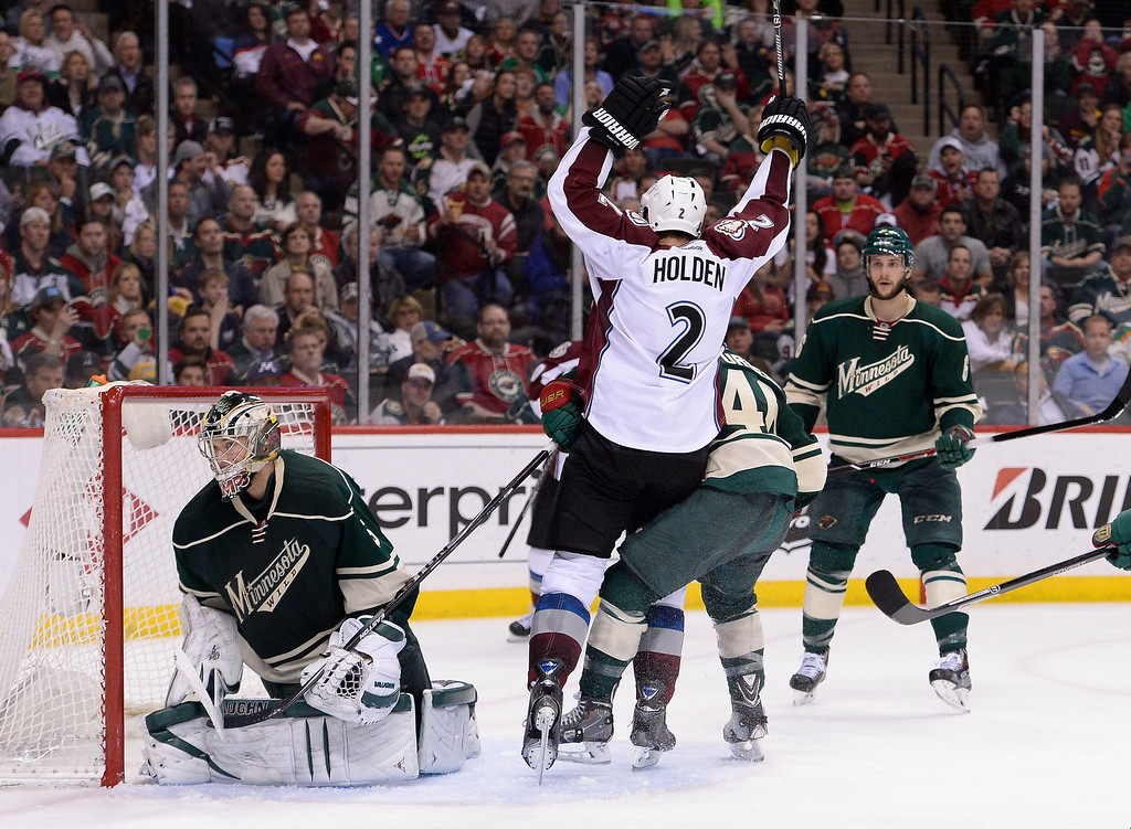 . Colorado Avalanche defenseman Nick Holden (2) celebrates his on Minnesota Wild goalie Darcy Kuemper (35) during the second period April 28, 2014 in Game 6 of the Stanley Cup Playoffs at Xcel Energy Center.  (Photo by John Leyba/The Denver Post)