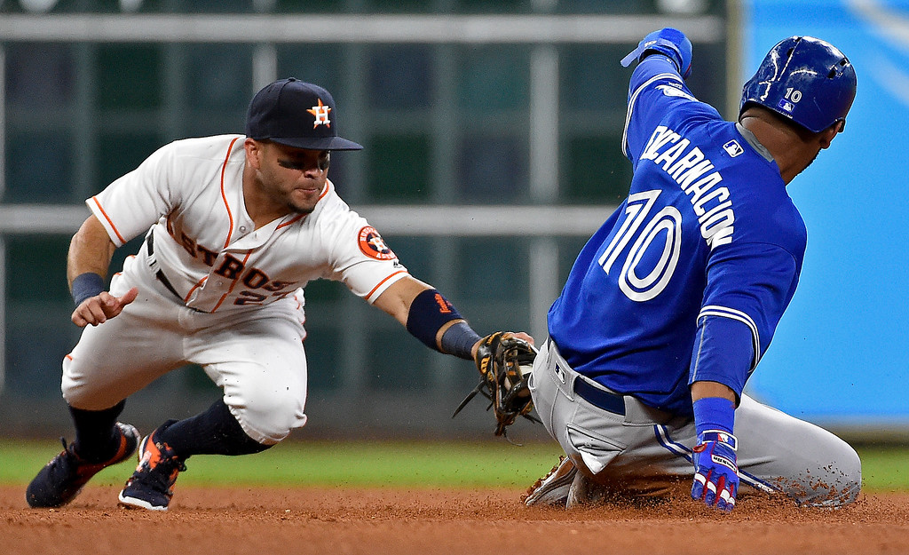 . Toronto Blue Jays designated hitter Edwin Encarnacion (10) slides safely into second on a sacrifice fly by Michael Saunders, beating the tag of Houston Astros second baseman Jose Altuve in the fourth inning of a baseball game, Monday, Aug. 1, 2016, in Houston. (AP Photo/Eric Christian Smith)