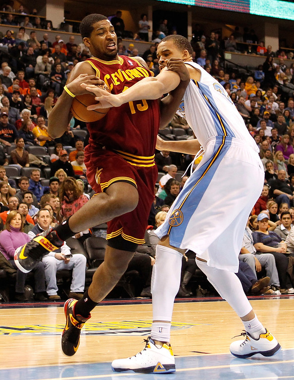 . Tristan Thompson #13 of the Cleveland Cavaliers drives in the first half against JaVale McGee #34 of the Denver Nuggets at Pepsi Center on January 11, 2013 in Denver, Colorado. (Photo by Chris Chambers/Getty Images)