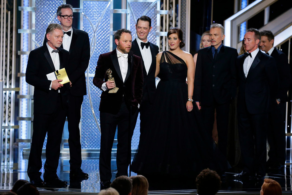 ". In this image released by NBC, Noah Hawley, third from left, accepts the award for best mini-series or TV movie for the series ""Fargo\"" at the 72nd Annual Golden Globe Awards on Sunday, Jan. 11, 2015, at the Beverly Hilton Hotel in Beverly Hills, Calif. (AP Photo/NBC, Paul Drinkwater)"