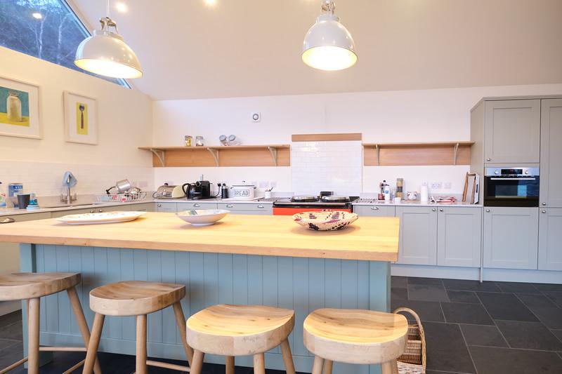 Oak shelves with painter birch ply brackets.