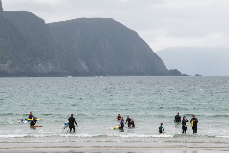Tourist enjoying on the beach, Keel Beach, Achill Island, County Mayo, Republic of Ireland