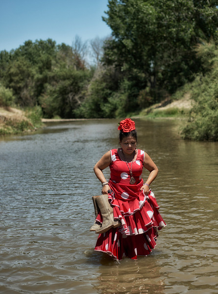 woman crossing the river,el rocio,spain.jpg