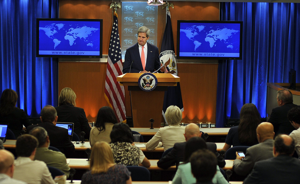 """. US Secretary of State John Kerry speaks on Syria at the State Department in Washington, DC, on August 26, 2013. The United States said Tuesday that chemical weapons had been used against Syrian civilians and warned President Barack Obama would demand accountability for this \""""moral obscenity.\"""" Employing his strongest language yet, Kerry said Washington was still examining evidence, but left no doubt that Bashar al-Assad\'s regime would be blamed. JEWEL SAMAD/AFP/Getty Images"""