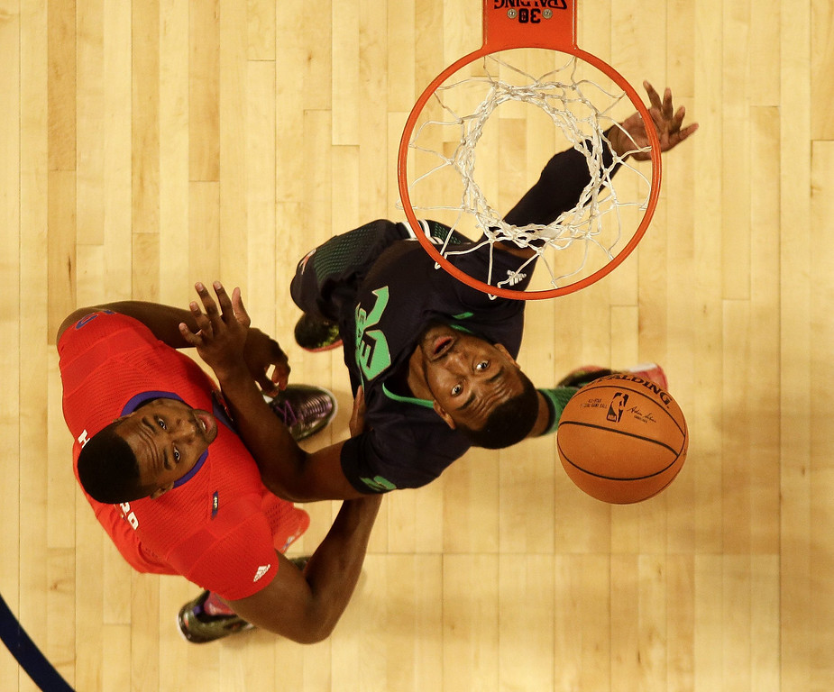 . Eastern Conference guard John Wall (R) goes to the basket against Western Conference center Dwight Howard  in the first half during the 63rd NBA All-Star Game in New Orleans, Louisiana.  EPA/GERALD HERBERT / POOL