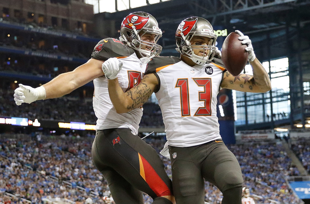 . DETROIT, MI - DECEMBER 7: Mike Evans #13 celebrates his fourth quarter touchdown with Luke Stocker #88 of the Tampa Bay Buccaneers while playing the Detroit Lions at Ford Field on December 7, 2014 in Detroit, Michigan. (Photo by Leon Halip/Getty Images)