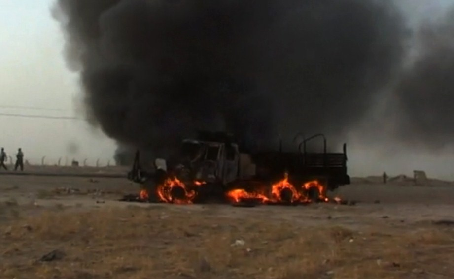 . A picture taken with a mobile phone shows a vehicle ablaze on a road in Hawijah, west of Kirkuk, in northern Iraq on June 11, 2014. Jihadists seized all of Mosul and Nineveh province, long a militant stronghold and one of the most dangerous areas in the country, and also took areas in Kirkuk province, to its east, and Salaheddin to the south. STR/AFP/Getty Images