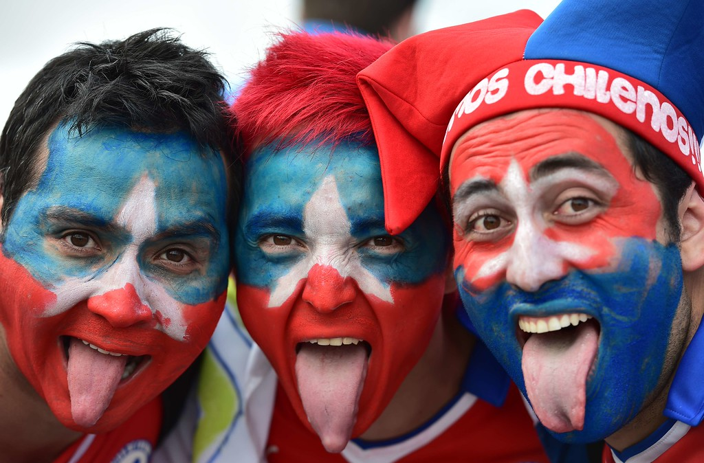 . Chile fans cheer outside the Corinthians Arena in Sao Paulo as they arrive for the Group B football match between Netherlands and Chile during the 2014 FIFA World Cup on June 23, 2014.  AFP PHOTO / NELSON ALMEIDA/AFP/Getty Images
