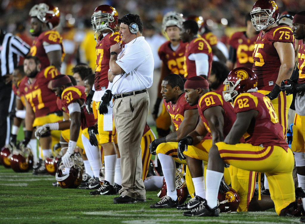 . USC coach Ed Orgeron watches as Marcus Martin is tended to after being injured in the first quarter. UCLA and USC played in a matchup of cross town rivals at the Los Angeles Memorial Coliseum in Los Angeles, CA.  photo by (John McCoy/Los Angeles Daily News)