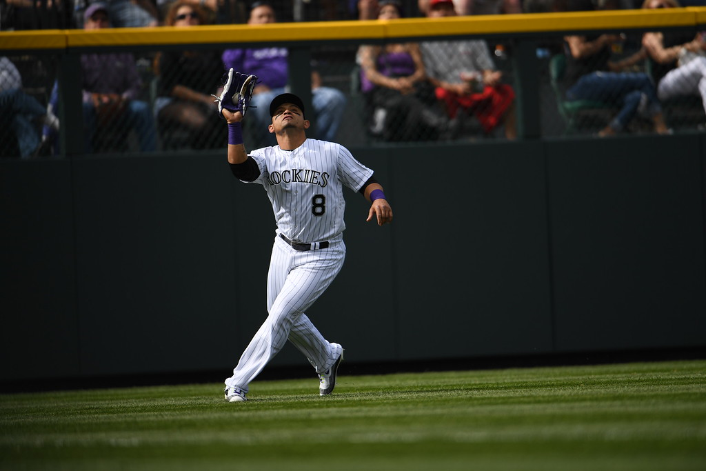 . Gerardo Parra (8) of the Colorado Rockies makes a catch in the fourth inning. The Colorado Rockies played the San Diego Padres Friday, April 8, 2016 on opening day at Coors Field in Denver, Colorado. (Photo By RJ Sangosti/The Denver Post)